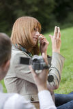 Man filming woman by make up Royalty Free Stock Photos