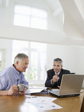 Man With Financial Advisor At Table Stock Images