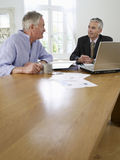 Man With Financial Advisor At Table Stock Photography