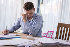 Man in financial stress. A looking at his financial situation or working at home royalty free stock images