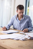 Man in financial stress. A looking at his financial situation or working at home Royalty Free Stock Photos