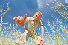 Man find some in grass. Royalty Free Stock Images