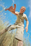 Man find some in grass. royalty free stock photography