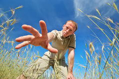 Man find some in grass Royalty Free Stock Photo