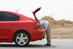 Man finding. A man finding in car trunk Stock Photos