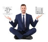 Man finding balance between work and life. On white background royalty free stock photo