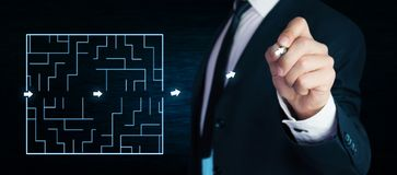 Man finding the solution of a labyrinth. Business concept Stock Images