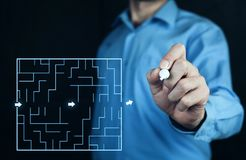 Man finding the solution of a labyrinth. Business concept Stock Photography