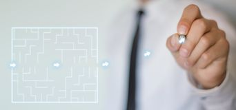 Man finding the solution of a labyrinth. Business concept Stock Image