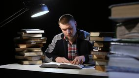 Man finds information that was looking for and was glad. Black background stock footage