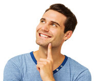 Man With Finger On Chin Against White Background Stock Photo