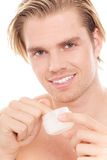 Man with finger in creme Stock Photos