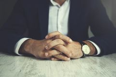 Man finger crossed stock photography