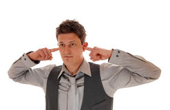 Man with finger in ear's. Royalty Free Stock Photography