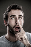 Man with a finger in his nose Royalty Free Stock Photos