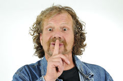 Man with finger on lips Stock Images