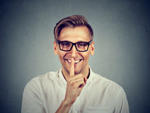 Man with finger on lips Shhhh quiet, silence, secret gesture Stock Photography