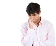 Man with finger in mouth sucking thumb or biting fingernail in anxiety and stress Stock Image