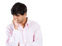 Man with finger in mouth sucking thumb or biting fingernail in anxiety and stress Stock Photography