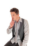Man with finger over mouth. Royalty Free Stock Images