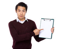 Man finger point to blank page of clipboard Royalty Free Stock Images