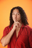 Man with finger to his lips Stock Photo
