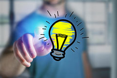 Man finger touching a hand drawn bulb lamp icon on a futuristic. View of a Man finger touching a hand drawn bulb lamp icon on a futuristic interface - technology Royalty Free Stock Images