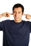Man with Fingers in His Ears Stock Photography