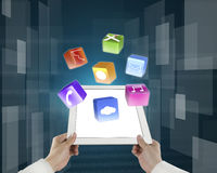 Man fingers holding light palmtop with apps. And tech digital background Stock Photography