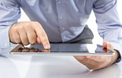 Man fingers touching screen on digital tablet Royalty Free Stock Photography
