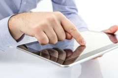 Man fingers touching screen on digital tablet Stock Photos