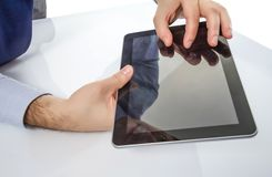 Man fingers touching screen on digital tablet Royalty Free Stock Image