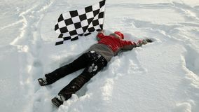 Man with finish flag on snow Royalty Free Stock Photos