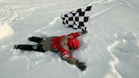Man with finish flag on snow Stock Image