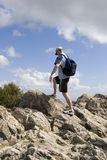 Man finishing hike stock photo