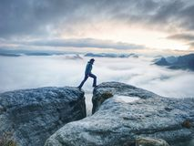 Free Man Finnaly Standing On Rock And Enjoy Foggy Mountain View Stock Photography - 165731202