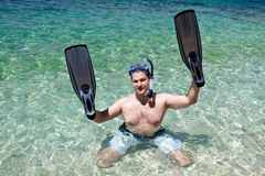 Man with fins on the hands Royalty Free Stock Images