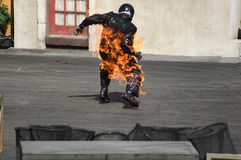 Man on Fire. From motorbike accident Royalty Free Stock Image