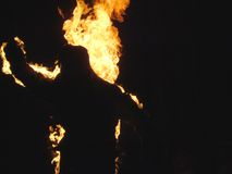 Man on fire. Man playing caught with fire Royalty Free Stock Images