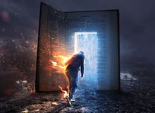 Man on fire and Bible. A man on fire runs towards an open Bible with refreshing rain royalty free stock photos