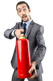 Man with fire extinguisher - firefighting concept. Man with fire extinguisher in firefighting concept stock photos