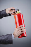 Man with fire extinguisher - firefighting concept Stock Image