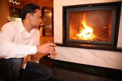 Man and fireplace Stock Photos
