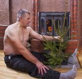 Man at the fireplace. Stock Image