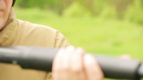 A man fires a rifle Royalty Free Stock Photography