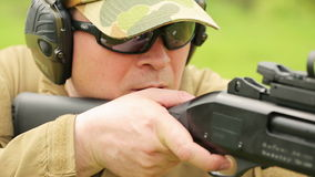 A man fires a rifle stock video
