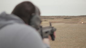 Man Fires Semi Automatic Assault Rifle to Shoot Exploding Target stock footage
