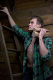 Man with firewood in the hands of climbing stairs Stock Photo