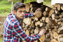 Man with firewood Stock Photo
