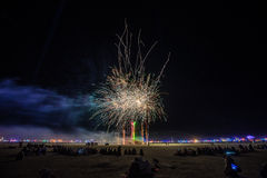 The Man and Fireworks during the Burn at Burning Man 2015 Royalty Free Stock Photos